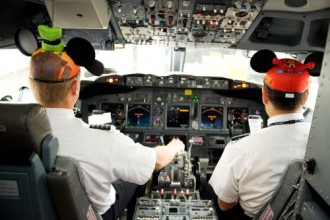 "Alaska Airlines pilots Rob Abrom and Andrew Blank prepare the ""Adventure of Disneyland Resort"" for its inaugural flight to Orange County, Calif."