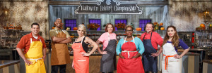 Contestants, from left, Brad Rudd, Damienx Bagley, Amy Strickland, Michelle Antonishek Tamara Brown, John Schopp, and Veronica von Borstel pose for a portrait, as seen on Food Network's Halloween Baking Championship, Season 2.