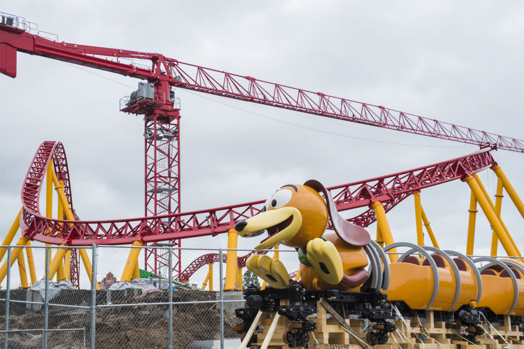 The first Slinky Dog Dash ride vehicle arrives on the site of Toy Story Land