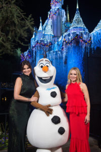 Tony Award-winning actress Idina Menzel (left) and fellow 'Frozen' star Kristen Bell join Olaf just moments before performing on the steps of Sleeping Beauty Castle at Disneyland Park