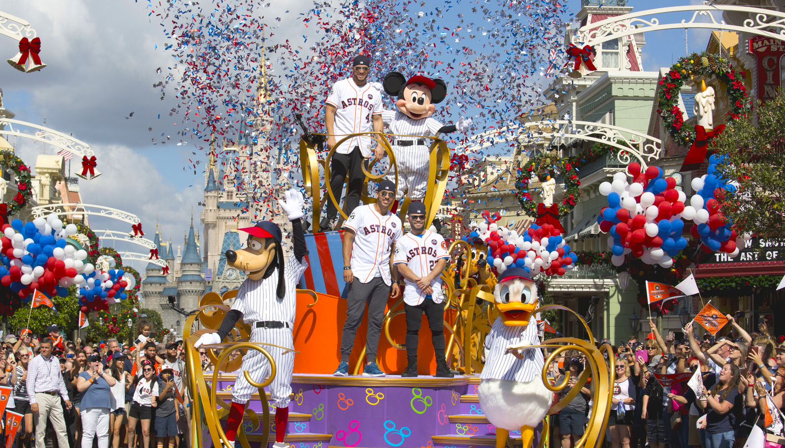 Houston Astros star players (top, then bottom l-r) World Series MVP George Springer, All-Star Carlos Correa and American League batting champion Jose Altuve lead off a World Series victory parade Saturday, Nov. 4, 2017, at Magic Kingdom Park in Lake Buena Vista, Fla. The Walt Disney World Parade saluted the team's first world title in its 56-year history. (Gregg Newton, photographer)