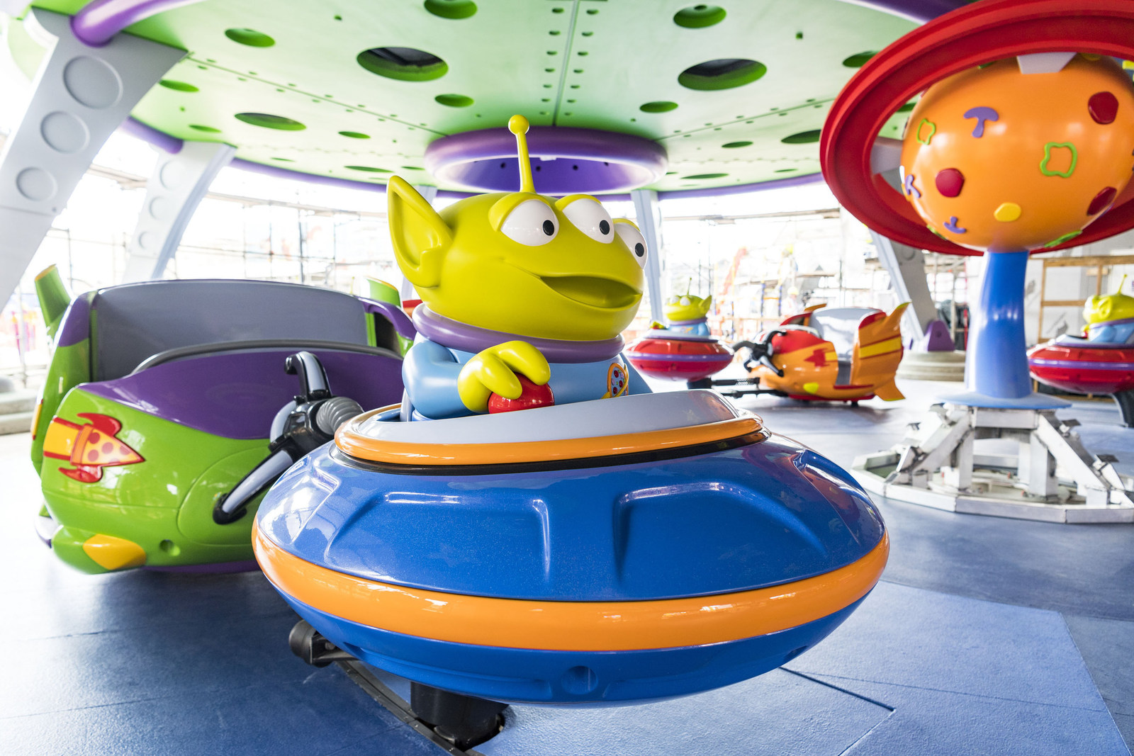 "Little green aliens from the hit Disney•Pixar ""Toy Story"" films pilot toy rocket ships in the Alien Swirling Saucers attraction that will be part of the new Toy Story Land"