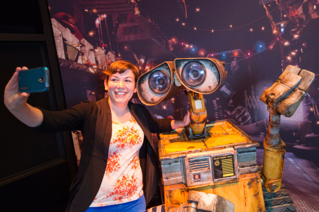 Wall-E takes a selfie at the Science of Pixar Exhibit